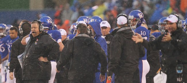 Kansas head coach Charlie Weis, left, watches after a fake field-goal attempt fell well short of a first down during the first quarter on Saturday, Oct. 13, 2012 at Memorial Stadium.