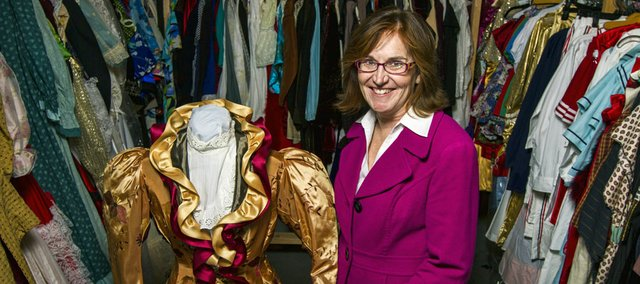 "Jane Pennington poses with a costume she designed for Theatre Lawrence's production of ""Sherlock Holmes: The Final Adventure"" on Oct. 4 at the Theatre Lawrence warehouse, 1705 Haskell Ave., Unit B. Theatre Lawrence will rent out its costumes for the first time this year."