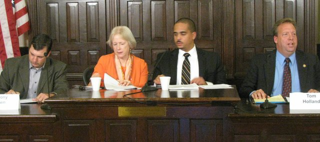 Candidates in seven races met Monday for forums that were telecast live on Channel 6. Pictured here are from left to right state Rep. Anthony Brown, R-Eudora, moderators Ann Gardner, editorial page editor of the Lawrence Journal-World, and Cory Smith, 6News anchor, and state Sen. Tom Holland, D-Baldwin City.