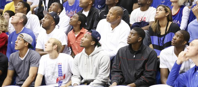 Wayne Selden, middle front row, sits behind the bench during Late Night in the Phog on Friday, Oct. 12, 2012 at Allen Fieldhouse. Selden was one of 24 players selected for the 2013 McDonald's All-American game.