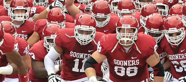 Oklahoma players take the field before their game Saturday against Texas in Dallas. The Sooners will entertain Kansas on Saturday.