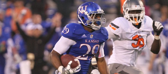 Kansas running back James Sims takes off for a touchdown past Oklahoma State defensive end Ryan Robinson during the fourth quarter on Saturday, Oct. 13, 2012 at Memorial Stadium.