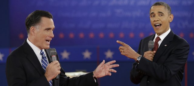Republican presidential nominee Mitt Romney and President Barack Obama exchange views during the second presidential debate Tuesday at Hofstra University in Hempstead, N.Y.