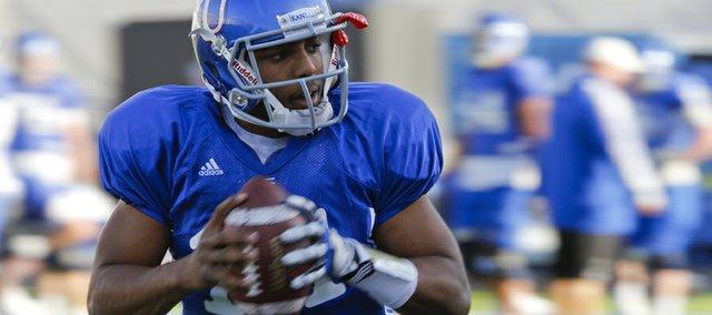 Kansas backup quarterback Michael Cummings works out during practice on Wednesday, Oct. 10, 2012 at Memorial Stadium.