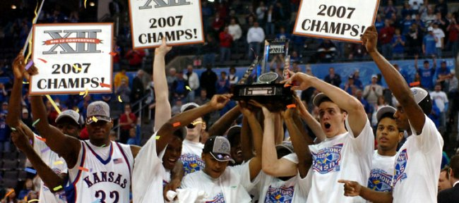 The 2006-2007 Kansas University men's basketball team hoists the Big 12 Tournament Championship trophy after an 88-84 victory over Texas on March 11, 2007.