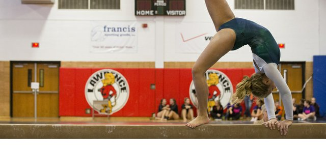Free State's Annie Soderberg competes on the balance beam during the 2012 6A gymnastics meet, held Saturday, Oct. 20, 2012 at LHS.