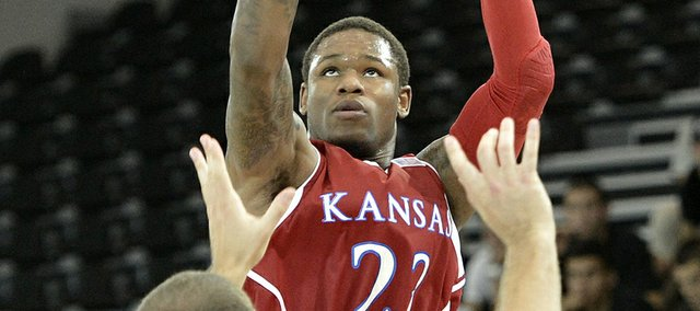 Kansas University's Ben McLemore shoots over Switzerland's Dusan Mladjan in Fribourg, Switzerland, Tuesday, Aug. 7, 2012.