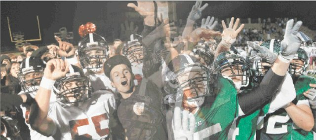 Lawrence High, left, celebrated a 20-0 victory over Free State last fall, while Free State had the longest winning streak in the City Showdown — five years from 2006 to 2010 — including this on-field merriment, at right, after Win No. 4 in 2009. The 16th meeting between the rivals will kick off at 7 p.m. Friday at LHS.