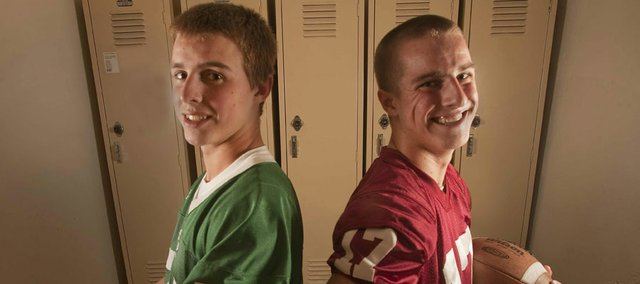 The cross-town football rivalry hits close to home for the Hofer brothers, Shane Hofer, left, a sophomore on the Free State High School squad, and Drake Hofer, a senior standout at Lawrence High School. The game will be played tonight at LHS. Both teams are 7-1 this year. Free State leads the series, 8-7.
