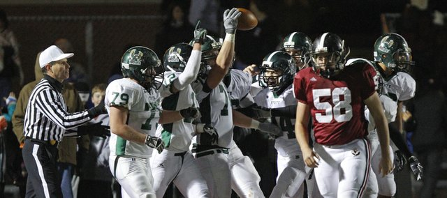 Free State players celebrate with offensive lineman Cody Standclift, after Stanclift intercepted a batted pass and ran it in for a touchdown against Lawrence High during the fourth quarter on Friday, Oct. 26, 2012 at Lawrence High.