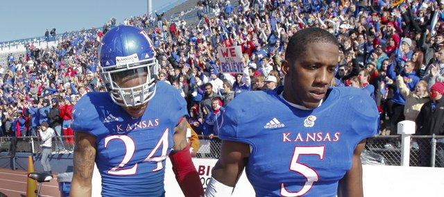 Deflated Kansas defenders Greg Brown (5) and Bradley McDougald (24) make their way off the field following the Jayhawks&#39; heartbreaking 21-17 loss to Texas on Saturday, Oct. 27, 2012 at Memorial Stadium.