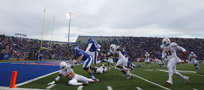 Kansas receiver Christian Matthews (12) gets a block from lineman Tanner Hawkinson (72) as he hurdles into the endzone against Texas during the second quarter on Saturday, Oct. 27, 2012 at Memorial Stadium.
