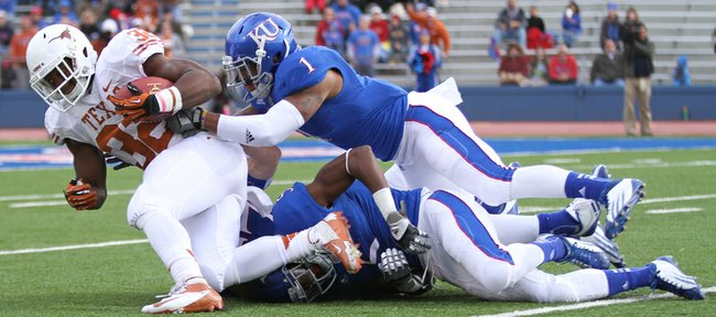 Kansas safety Lubbock Smith drags down Texas running back Johnathan Gray during the first quarter on Saturday, Oct. 27, 2012 at Memorial Stadium.