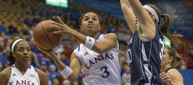 Kansas guard Angel Goodrich (3) floats past Washburn&#39;s Brittney Lynch in the lane during their exhibition game Sunday, Oct. 28, 2012 at Allen Fieldhouse.