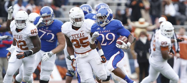 Kansas running back James Sims blows past the Texas defense on a long run during the second quarter on Saturday, Oct. 27, 2012 at Memorial Stadium.