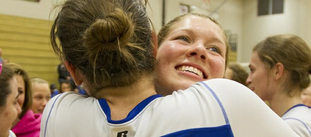 Veritas' Kristen Finger (14) hugs Abi Bartlow as the two celebrate their victory over Wichita in the 2012 Kansas Christian Athletic Association championship volleyball match Saturday, Oct. 27, 2012 at Free State High School. Veritas defeated Wichita 2-0 to win the championship.