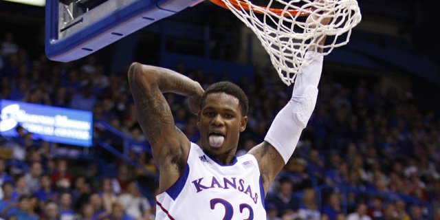 Kansas guard Ben McLemore flashes his tongue after a put-back dunk against Emporia State during the second half, Tuesday, Oct. 30, 2012 at Allen Fieldhouse.