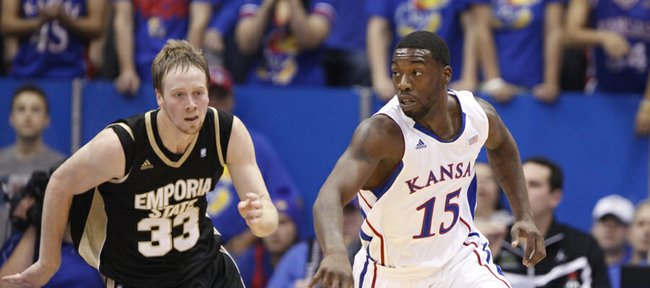 Kansas guard Elijah Johnson pushes the ball up the court against Emporia State forward Michael Harris during the first half, Tuesday, Oct. 30, 2012 at Allen Fieldhouse.