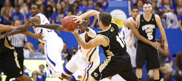 Kansas guard Rio Adams looks for a steal as he defends Emporia State guard Taylor Euler during the second half, Tuesday, Oct. 30, 2012 at Allen Fieldhouse.