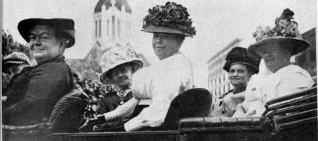 Suffragettes in Governor Walter Roscoe Stubb's automobile, going after the vote in Topeka, Kansas. The women are identified as: (l to r) Laura Clay, President of Kentucky Equal Rights Association; Lucy B. Johnston; Sarah A. Thurston; Helen Eacker; and Stella H. Stubbs. They were all members of the Kansas Equal Suffrage Association.