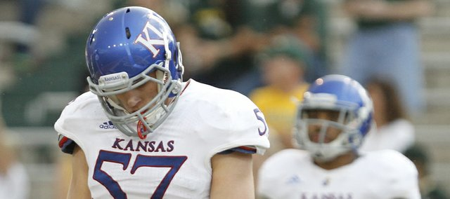 Kansas linebacker Jake Love hangs his head after a Baylor touchdown during the third quarter, Saturday, Nov. 3, 2012 at Floyd Casey Stadium in Waco, Texas.