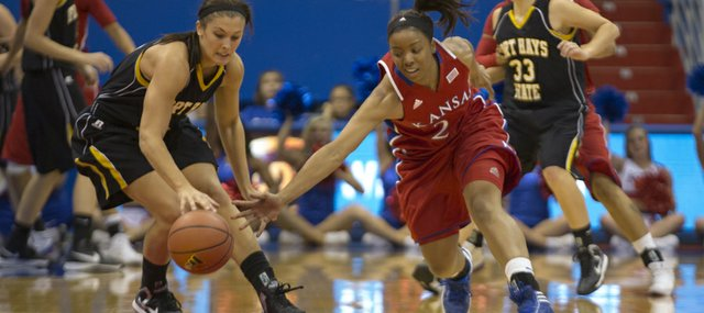 Kansas' CeCe Harper, right, swipes the ball away from Katelyn Edwards during Kansas' final exhibition game against Fort Hays State University, Sunday, Nov. 4, 2012 at Allen Fieldhouse. The Jayhawks open the season against Idaho State Sunday at 2 p.m.