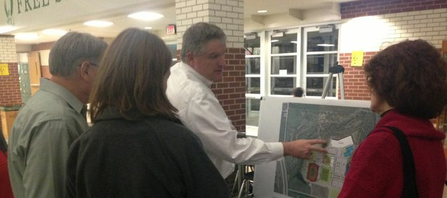 Lawrence City Manager David Corliss discusses plans for a proposed new city recreation center at a public meeting Thursday night at Lawrence Free State High School.