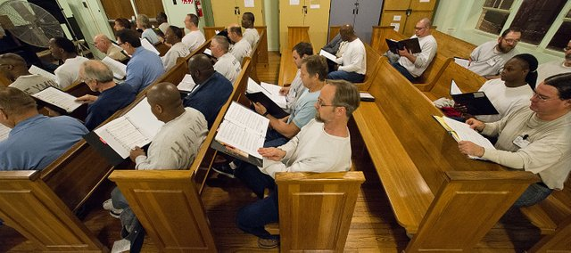 Inmates sit in the pews of the East Unit chapel during rehearsal of the East Hill Singers at the Lansing Correctional Facility.