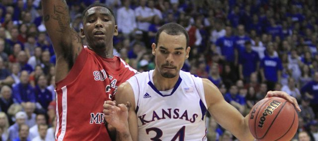 KU forward Perry Ellis (34) drives against Southeast Missouri State's Tyler Stone on Friday at Allen Fieldhouse.
