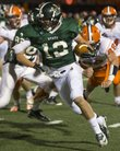 Free State's Joe Dineen (12) avoids Olathe East's Connor Alexander (88) as he turns the corner to head upfield during their quarterfinal playoff game, Friday, Nov. 9, 2012 at FSHS. The Firebirds defeated the Hawks 28-17 and will advance to play Shawnee Mission West in the state semifinals next week.