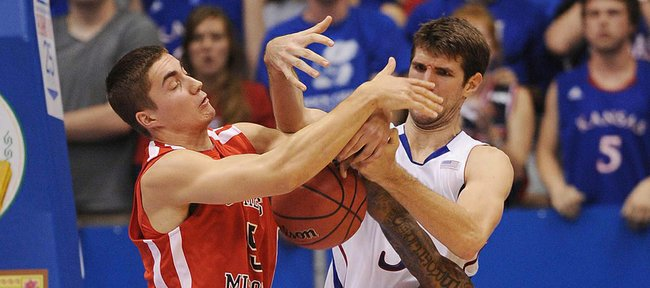 KU's center Jeff Withey ties up with Southeast Missouri's Jacob Tolbert as KU's Ben McLemore (23) goes down on Friday, Nov. 9, 2012.