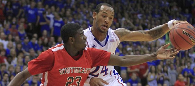 KU&#39;s Travis Releford (24) gets control against Southeast Missouri State&#39;s Marland Smith (23) on Friday at Allen Fieldhouse.
