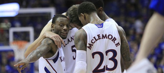 KU sophomore Naadir Tharpe, left front, gets his team together in the final minutes against Southeast Missouri State on Friday at Allen Fieldhouse. KU defeated SEMO, 74-55.