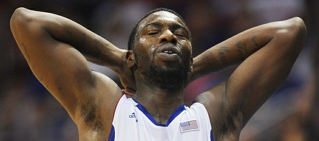 KU's Elijah Johnson catches his breath after suffering a blow to the chest against Southeast Missouri State on Friday, Nov. 9, 2012, at Allen Fieldhouse.