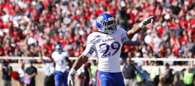 Kansas running back James Sims salutes a pack of KU fans after his touchdown against Texas Tech during the first quarter on Saturday, Nov. 10, 2012 at Jones AT&T Stadium in Lubbock, Texas.