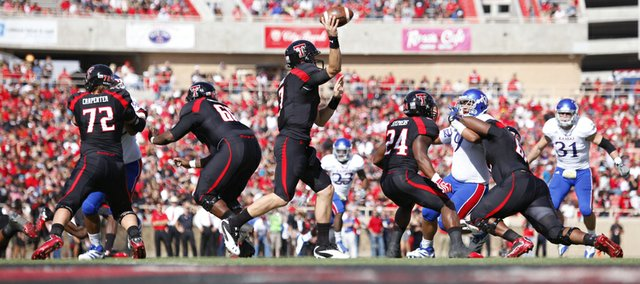 Texas Tech quarterback Seth Doege throws against the Kansas defense during the second quarter on Saturday, Nov. 10, 2012 at Jones AT&T Stadium in Lubbock, Texas.