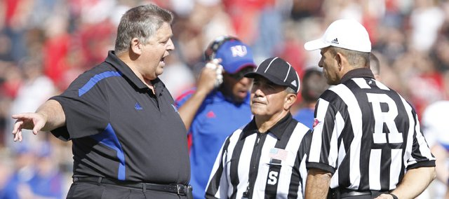 Kansas head coach Charlie Weis argues with game officials over a call on a Kansas punt during the second quarter on Saturday, Nov. 10, 2012 at Jones AT&T Stadium in Lubbock, Texas.