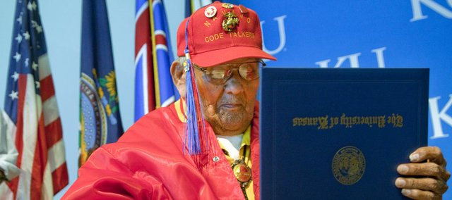 Chester Nez, 91, the last survivor of the original 29 World War II Navajo Code Talkers, received a Bachelor of Fine Arts from Kansas University on Monday in a recognition ceremony at the Lied Center pavilion. Code Talkers transmitted messages in a code based on the Navajo language that was never broken. Nez was a Marine serving in the Pacific Theater.