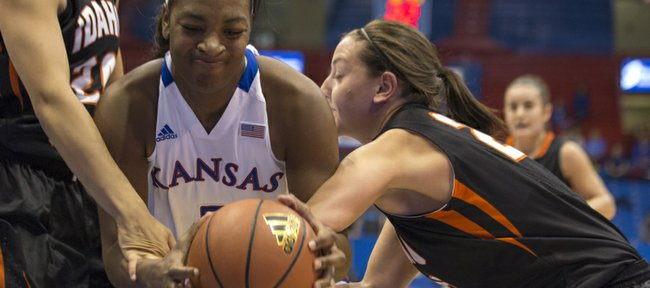 Kansas forward Bunny Williams, center, is harassed by a double team of Cydney Horton, left, and Ashleigh Vella during Kansas' game against Idaho State, Sunday, Nov. 11, 2012 at Allen Fieldhouse.