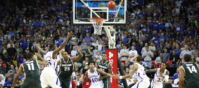 Michigan State forward Derrick Nix tosses a pass out to the perimeter against the Kansas defense late in the second half, Tuesday, Nov. 13, 2012 at the Georgia Dome in Atlanta.