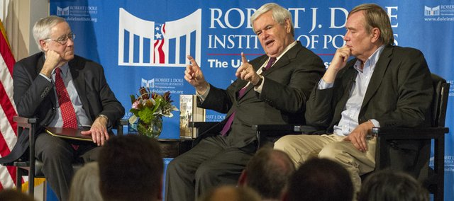 Former Speaker of the House Newt Gingrich, center, and Bill Forstchen, right, answer questions from Dole Institute director Bill Lacy about their latest historical fiction novel, Victory At Yorktown, Wednesday, Nov. 14, 2012 at the Dole Institute of Politics.