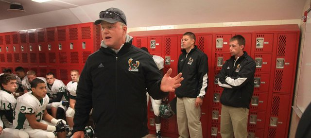Free State coach Bob Lisher gets his Firebirds pumped up for the Lions.