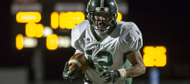 Free State's Joe Dineen finds some open space as he runs the ball against Leavenworth during their game Friday, Oct. 19, 2012 at Leavenworth.