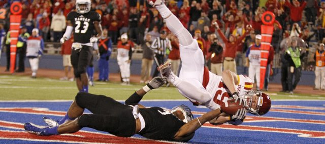 Iowa State receiver Josh Lenz bounces off Kansas cornerback Greg Brown as he falls into the endzone for a touchdown during the fourth quarter, Saturday, Nov. 17, 2012 at Memorial Stadium.