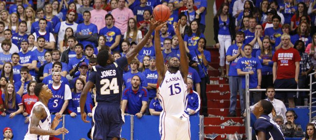 Kansas guard Elijah Johnson comes away with the ball from Chattanooga guard Casey Jones during the second half on Thursday, Nov. 15, 2012 at Allen Fieldhouse.