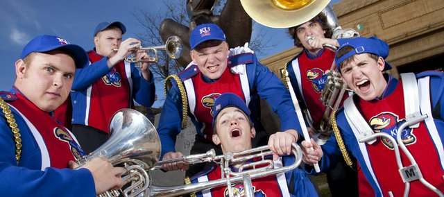 Kansas University band members, clockwise from left, Winston Heilman, Jeff Jasperson, Colin Lohrenz, Will Marsh, Chris Carter and Cody Janousek have been playing in bands together for 10 years, at West Junior High School, Free State High School and then at KU. The six played their final football game together on Saturday during the Jayhawks' game against Iowa State.