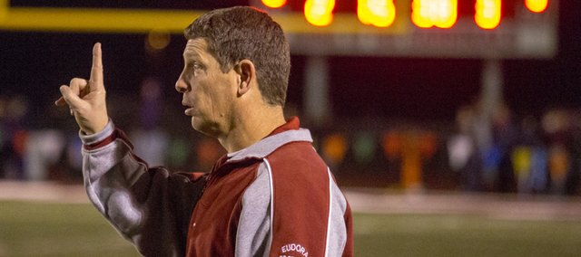 Eudora head coach Gregg Webb signals his team during Eudora's game against Piper in the Kansas Class 4A Sub-state championship, Friday, Nov. 16, 2012 in Eudora.