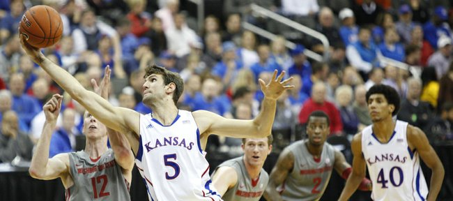 Kansas center Jeff Withey grabs a pass in the paint over Washington State forward Brock Motum during the first half of the CBE Classic, Monday, Nov. 19, 2012 at the Sprint Center in Kansas City, Missouri.