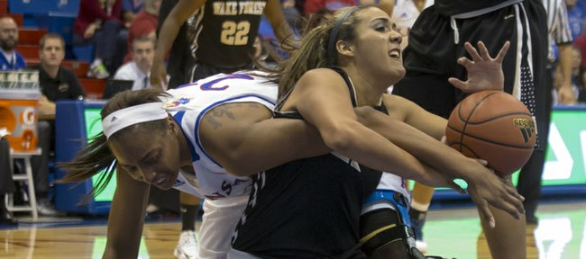 Kansas forward Carolyn Davis, left, gets tangled up with Sandra Garcia as they struggle to gain possession of a loose ball during Kansas' game against Wake Forest, Sunday, Nov. 18. 2012 at Allen Fieldhouse. Kansas held off Wake Forest 64-58 and improved its record to 3-0 on the season.