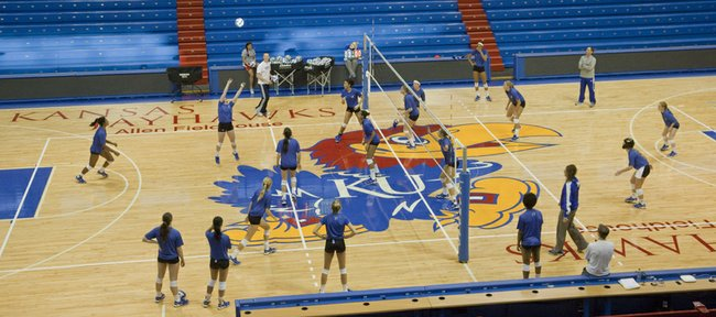 Kansas University's volleyball team practices at Allen Fieldhouse on Tuesday, Nov. 20, 2012, in preparation for their match with Saint Louis. Normally, the team practices and plays games at Horejsi Center, but will meet SLU Wednesday, Nov. 21, 2012, at Allen in anticipation of landing a home NCAA Tournament match.